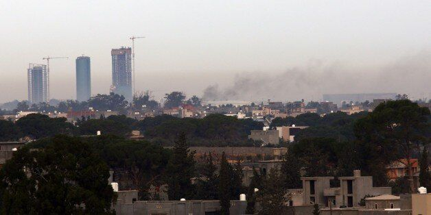 Smoke billows on November 25, 2014 from the Mitiga airport in an eastern suburb of the Libyan capital...