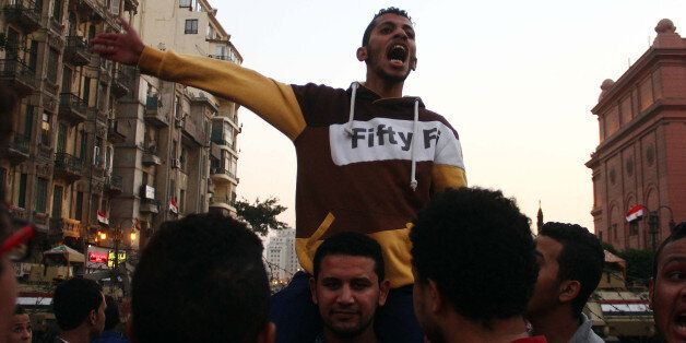 CAIRO, EGYPT - NOVEMBER 29: Hundreds of Egyptian people protest the court verdict, dropping charges against...
