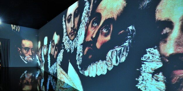Visitors walk as they visit the exhibition of paintings of Greek-born Spanish Renaissance master El Greco...