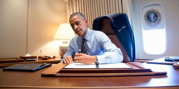 President Barack Obama signs two presidential memoranda associated with his actions on immigration in...
