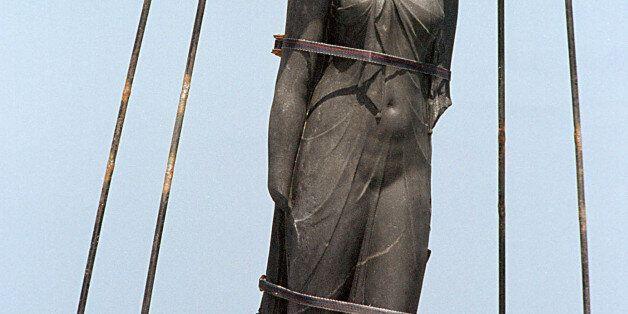 ABU QIR, EGYPT - JUNE 3: A 300-kilogram and 2.25-meter tall stone torso of the Egyptian Goddess Isis...