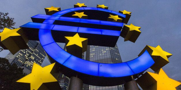 A euro sign sculpture stands illuminated in front of the European Central Bank (ECB) headquarters in...
