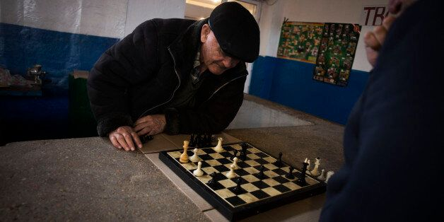 Tatars play chess within a market place in Bachisaray, a village with Tatar majority in  Ukraine, Sunday, March 16, 2014.  While Crimea's ethnic Russian majority may be in favor of joining Russia, the Tatars who were deported during World War II,  fear that they will once again be unwelcome in their homeland. (AP Photo/Manu Brabo)