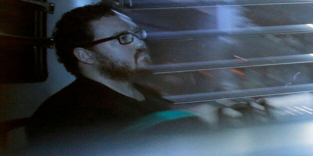 In this photo taken through a tinted glass, Rurik George Caton Jutting, a 29-years-old British banker,...