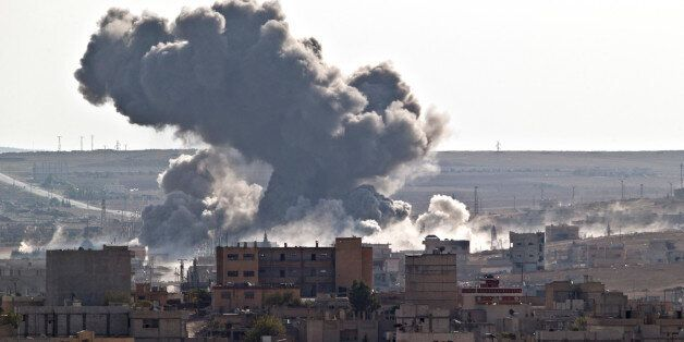 Smoke rises over the Syrian city of Kobani, following a US led coalition airstrike, seen from outside...