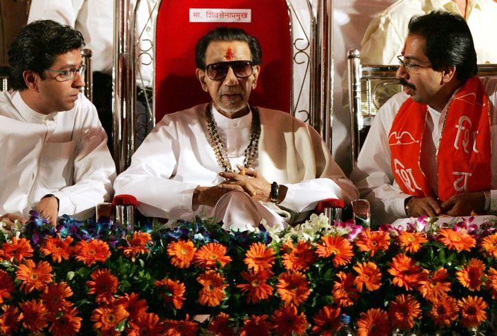 Raj Thackeray, Balasaheb Thackeray and Uddhav Thackeray at a rally in October 2005.