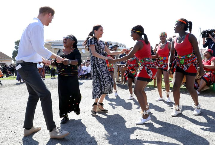 The Sussexes dance as they visit a Justice Desk initiative in Nyanga township.