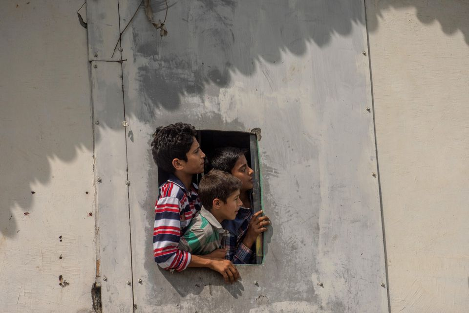 Kashmiri children look towards clashes between protesters and security forces on August 30, 2019. TheJammu...