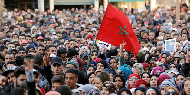 People attend a protest after two miners died while working in a clandestine coal mine, in Jerada, Morocco...