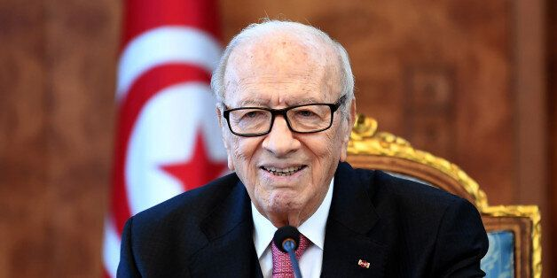 Tunisian President Beji Caid Essebsi attends a meeting with political parties, unions and employers on...