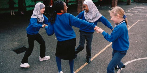 (Original Caption) Girls enjoying themselves on the playground of Melcombe Primary School, a formerly...