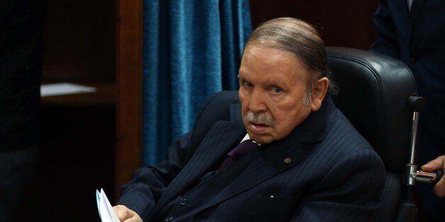Algerian President Abdelaziz Bouteflika heads to vote at a polling station in Algiers on November 23,...