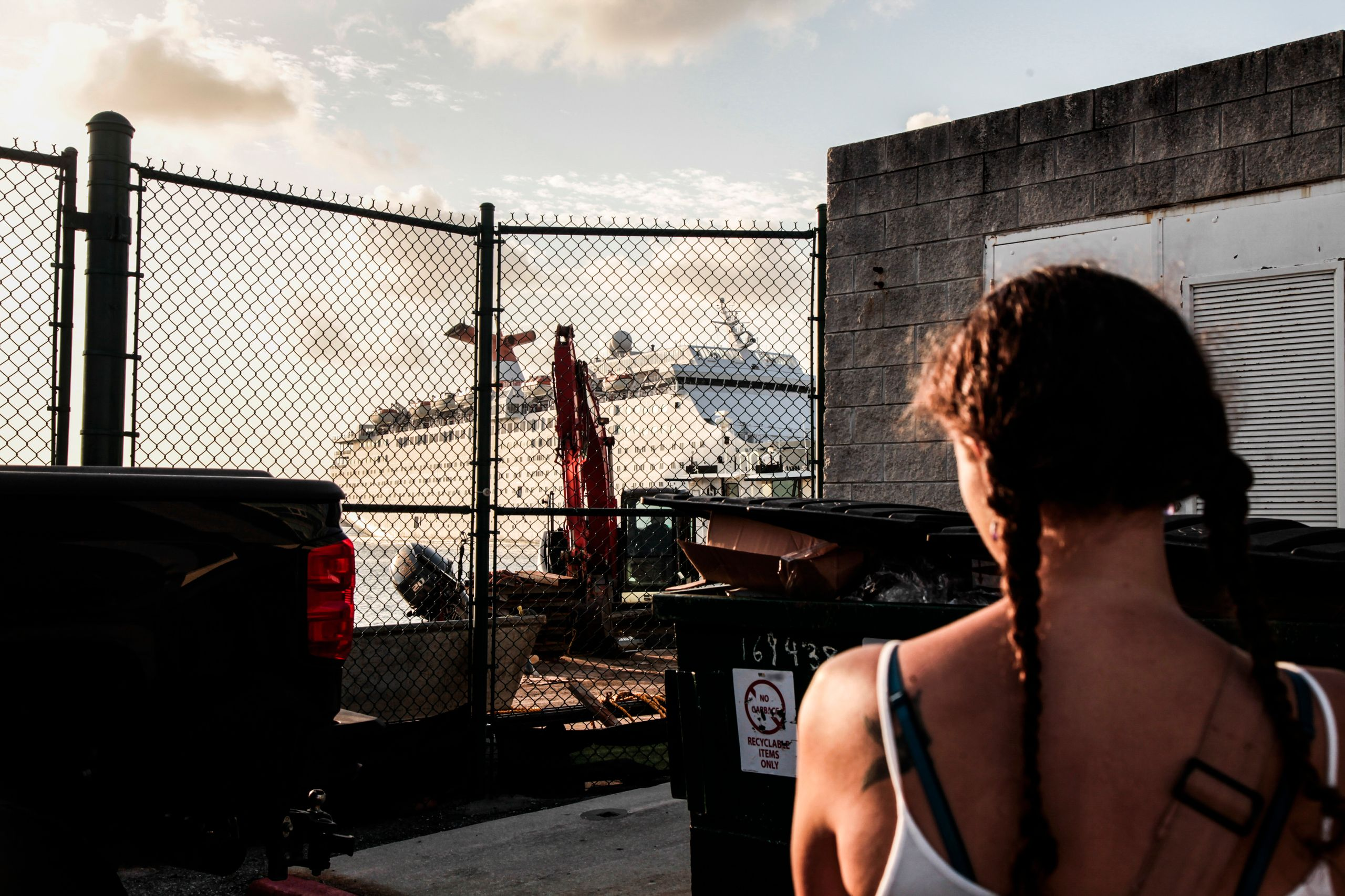 Sarah Renee Oźlański stands to watch the Grand Celebration start to dock. Oźlański waits for her Bahamian friend and infant t