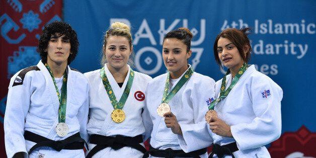 (From L) Azerbaijan's Khanim Huseynova (silver), Turkey's Busra Katipoglu (gold), Algeria's Amina Belkadi...