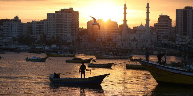 Palestinian fishermen work on their fishing boats at the sea port of Gaza City on January 25, 2018. (Photo...