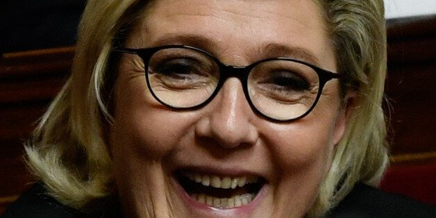 Head of French far-right National Front (FN) party and member of Parliament Marine Le Pen reacts as she...