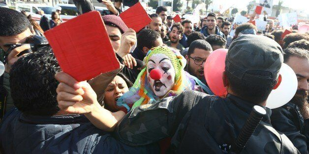 TUNIS, TUNISIA - JANUARY 26: A demonstrator, wearing a clown costume, from Tunisia's 'Fech Nestannew'...