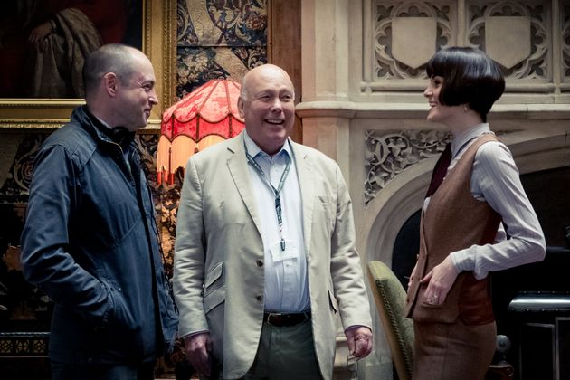 Producer Gareth Neame, writer and producer Julian Fellowes and actor Michelle Dockery on the set of Downton