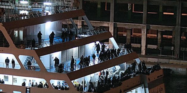 Passengers from the Algerian ferry 'Tariq Ibn Ziyad' wait onboard 15 December in Marseille, southern...