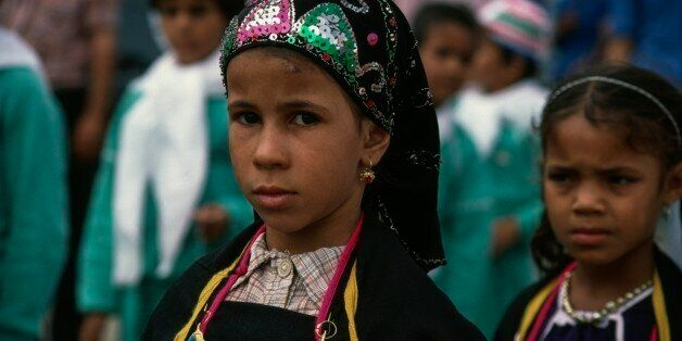 ALGERIA - MARCH 18: Berber girls during Independence Day celebrations, El Oued, Algeria. (Photo by DeAgostini/Getty