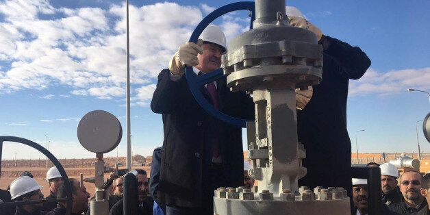 Abdelmoumen Ould Kaddour, Chief Executive of Algerian state energy firm Sonatrach, checks equipment during...
