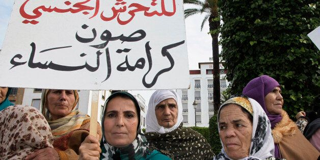 Women from various regions of Morocco hold placards as they protest against violence towards women, in...