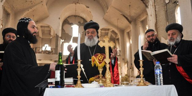 Syriac Orthodox Patriarch of Antioch, Ignatius Aphrem II, holds mass at the heavily damaged Syriac Orthodox...