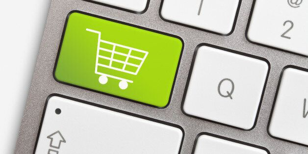 Computer keyboard with green key and shopping
