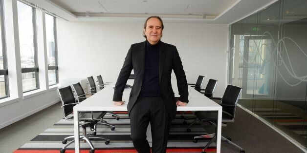 French telecom Iliad Group founder and Vice President Xavier Niel poses prior to a press conference to...