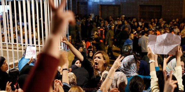 Nawal Benaissa (C) of the grassroots Al-Hirak Al-Shaabi movement shouts during a protest against official...
