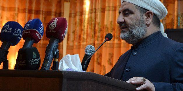 Sheikh Saleh al-Obeidi, head of the Muslim Scholars Forum of Mosul, delivers a speech at a graduation...