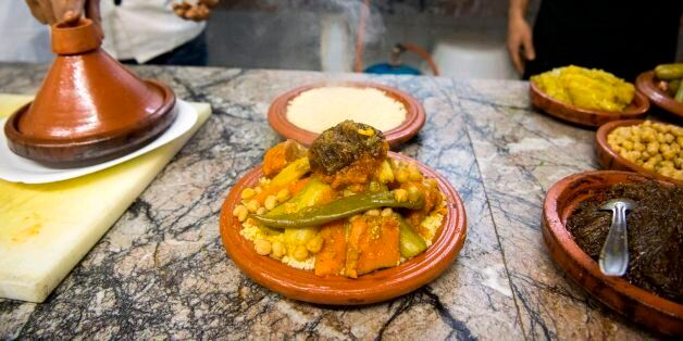 A Moroccan chef prepares a traditional couscous dish in a restaurant in the capital Rabat on January...