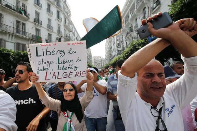 Algerian protesters chant slogans during a protest rejecting Algerian election announcement for December...