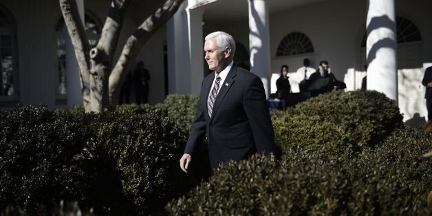 US Vice President Mike Pence arrives before US President Donald Trump speaks live via video link to the...
