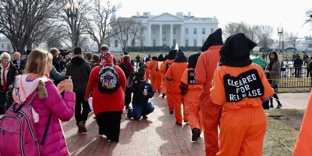 WASHINGTON DC, USA - JANUARY 12: Protesters, wearing orange prisoner jumpsuits, those symbolize Guantanamo...