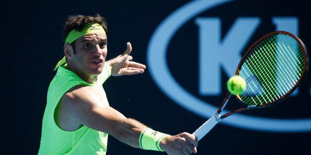 Tennis - Australian Open - Melbourne, Australia, January 17, 2018. Malek Jaziri of Tunisia hits a shot...