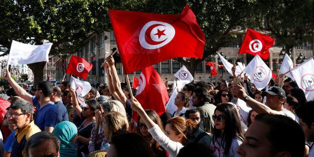 Tunisians demonstrate against a bill that would protect those accused of corruption from prosecution...