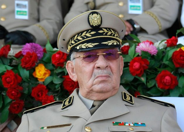 FILE - In this Sunday, July 1, 2018 file picture Algerian Gen. Ahmed Gaid Salah presides a military parade...