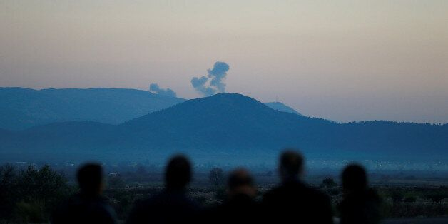 Smoke rises from the Syria's Afrin region, as it is pictured from near the Turkish town of Hassa, on...
