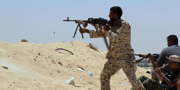 Fighters from the pro-government forces loyal to Libya's Government of National Unity (GNA) fire machine...