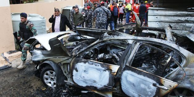 Lebanese security forces secure the area following a car bomb blast in the southern Lebanese port city...