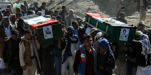 SANA'A, YEMEN – DECEMBER 26: People carry coffins of 11-members from one family after they were killed...