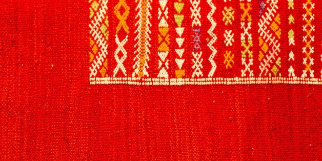 Handmade by berber woman colourful rugs in vibrant tones for sale in media