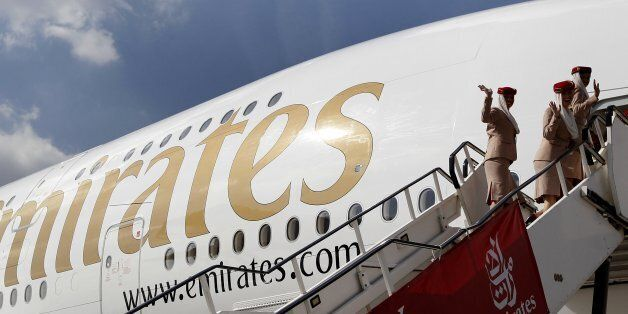 Emirates cabin crew board an Emirates Airbus A380-800 at Manchester Airport in Manchester, northern England,...