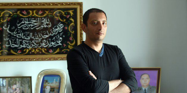 Tunisian blogger Yassine Ayari poses for a picture at home on April 17, 2015 in Tunis. Tunisian authorities...