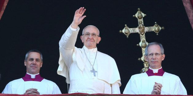 Pope Francis waves as he leads