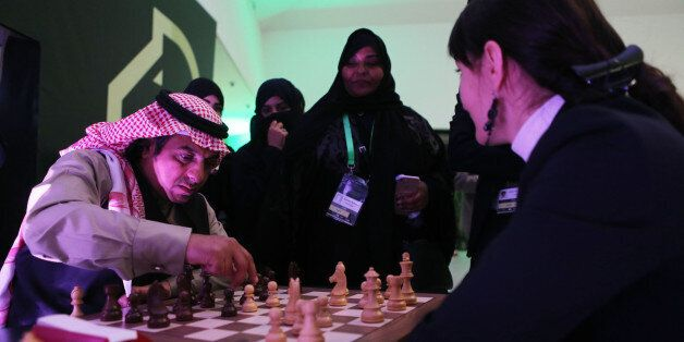 RIYADH, SAUDI ARABIA- DECEMBER 25: Attendees play chess for fun as they attend at the King Salman Rapid...
