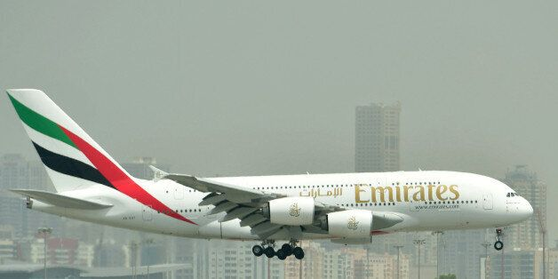 A picture take on September 14, 2017 shows an Airbus A380 of Emirates landing at the tarmac at Dubai's...