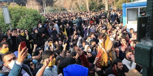 Iranian students protest at the University of Tehran during a demonstration driven by anger over economic...