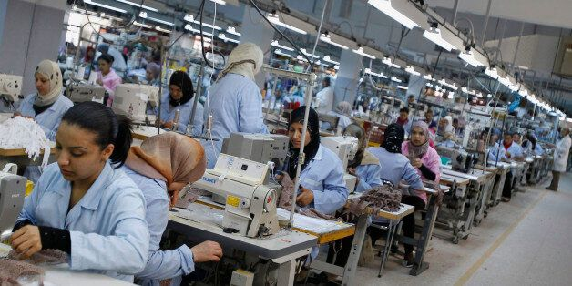 Tunisian Employees work at an underwear factory in Sfax, 260 km (162 miles) south of Tunis March 22,...
